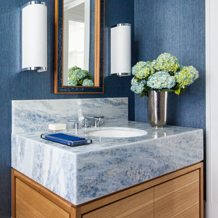 Example of a mid-sized transitional white floor bathroom design in New York with flat-panel cabinets, medium tone wood cabinets, blue walls, an undermount sink, marble countertops and blue countertops