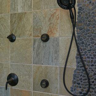 Example of a mid-sized coastal master pebble tile corner shower design in Philadelphia