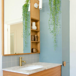 Scandinavian bathroom in Melbourne with flat-panel cabinets, medium wood cabinets, white walls, an undermount sink, grey benchtops, a single vanity and a floating vanity.