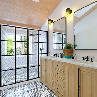 Inspiration for a scandinavian white tile multicolored floor bathroom remodel in San Diego with raised-panel cabinets, light wood cabinets, white walls, an undermount sink and gray countertops