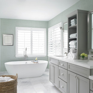 Large classic ensuite bathroom in Miami with a submerged sink, shaker cabinets, grey cabinets, a freestanding bath, an alcove shower, blue walls, engineered stone worktops, white tiles, metro tiles, marble flooring, grey floors and a hinged door.
