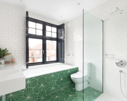 design ideas for a modern ensuite bathroom in london with flat panel cabinets a