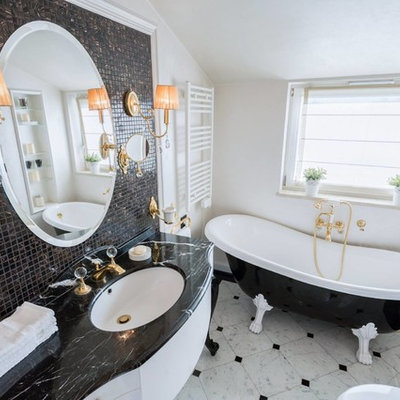 Inspiration for a mid-sized timeless brown tile and mosaic tile marble floor and gray floor claw-foot bathtub remodel in Other with flat-panel cabinets, white cabinets, beige walls and an undermount sink