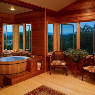 Bathroom - traditional light wood floor bathroom idea in Other with a hot tub