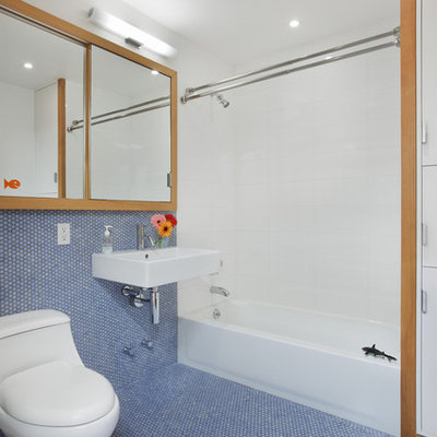 Trendy kids' blue tile and mosaic tile blue floor bathroom photo in New York with a wall-mount sink