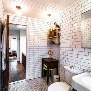 Claw-foot bathtub - small 1950s white tile and porcelain tile light wood floor claw-foot bathtub idea in New York with a two-piece toilet and beige walls