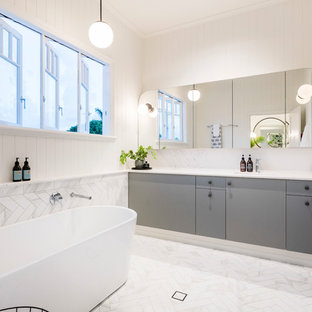 Design ideas for a transitional bathroom in Brisbane with limestone floors, marble benchtops, white floor and white benchtops.