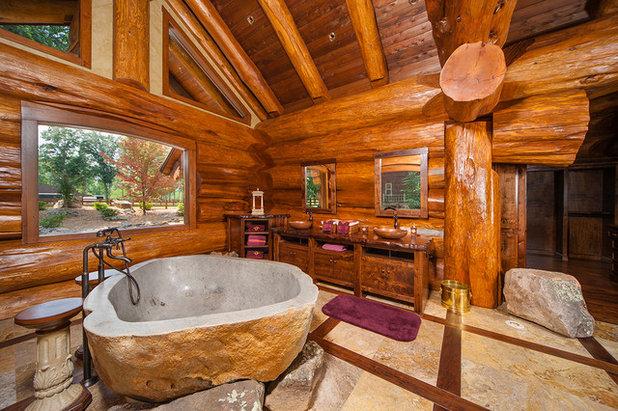 Rustic Bathroom by Pioneer Log Homes of British Columbia Ltd