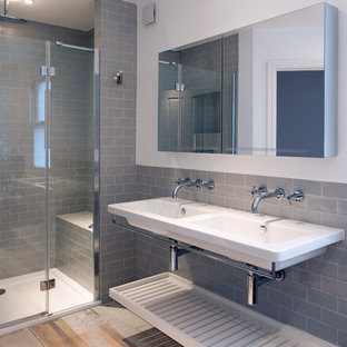 Inspiration for a contemporary bathroom in London with open cabinets, an alcove shower, metro tiles, an integrated sink, beige floors, a hinged door and white worktops.