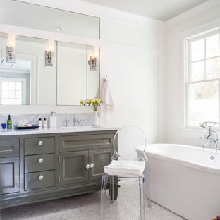 Example of a mid-sized transitional master ceramic floor bathroom design in Atlanta with recessed-panel cabinets, gray cabinets, marble countertops, a two-piece toilet and white walls