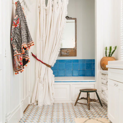 Inspiration for a mid-sized eclectic master blue tile and ceramic tile ceramic tile and multicolored floor bathroom remodel in Houston with shaker cabinets, white cabinets, white walls, a drop-in sink and a hinged shower door