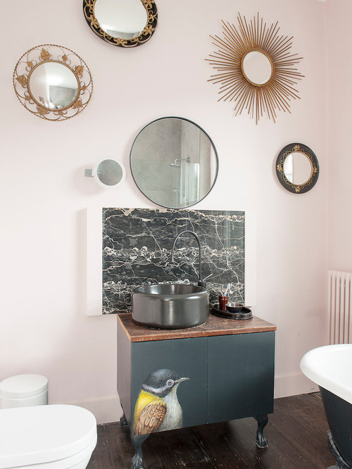 this is an example of a bohemian bathroom in sussex with flat panel cabinets - Eclectic Bathroom Interior