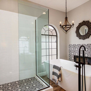 Bathroom - large mediterranean master black and white tile, multicolored tile and cement tile medium tone wood floor and multicolored floor bathroom idea in Phoenix with a hinged shower door and brown walls
