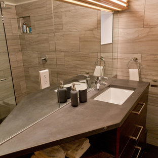 Bathroom - small modern 3/4 gray tile and porcelain tile porcelain floor and black floor bathroom idea in Portland with flat-panel cabinets, dark wood cabinets, a two-piece toilet, gray walls, an undermount sink, concrete countertops and black countertops