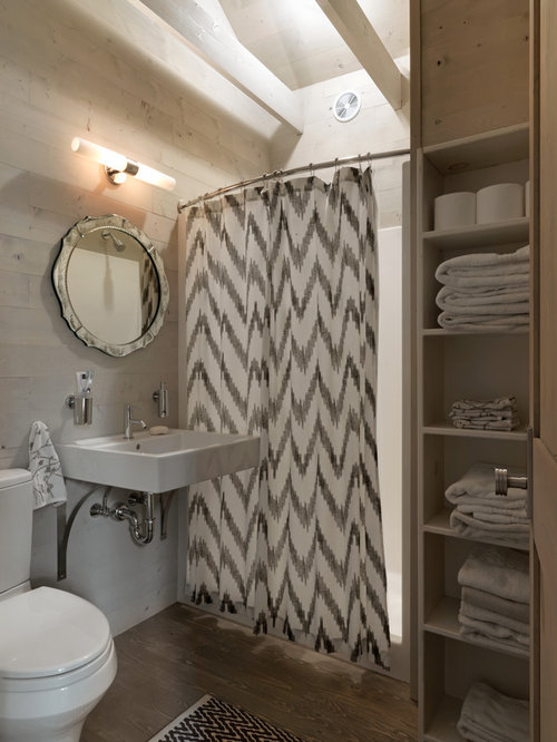 rustic alcove shower idea in burlington with a wallmount sink and a two