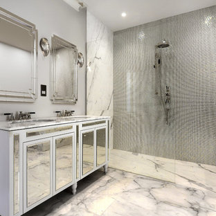 Photo of a contemporary ensuite bathroom in London with freestanding cabinets, white cabinets, a built-in shower, metal tiles, grey walls, marble flooring, a submerged sink, marble worktops, white floors, an open shower and white worktops.