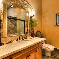 Tropical Bathroom by bobby vilas design
