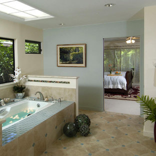 Example of an island style beige tile bathroom design in Hawaii with dark wood cabinets