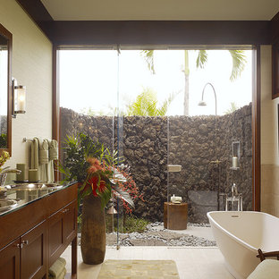 This is an example of a world-inspired bathroom in Hawaii with a freestanding bath.