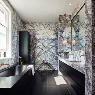 Design ideas for a mid-sized contemporary master bathroom in Melbourne with black cabinets, an undermount tub, a double shower, marble, an undermount sink, marble benchtops, black floor, a hinged shower door, flat-panel cabinets, multi-coloured tile and multi-coloured benchtops.