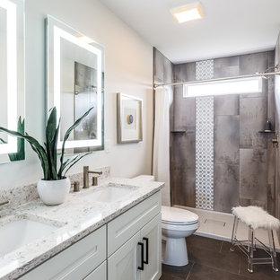 На фото: ванные комнаты в стиле современная классика с фасадами в стиле шейкер, белыми фасадами, душем в нише, серой плиткой, белыми стенами, врезной раковиной, серым полом, шторкой для душа и белой столешницей