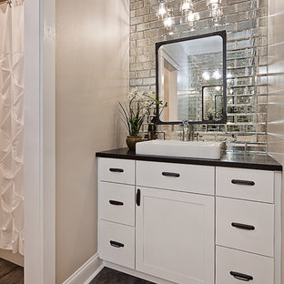 Inspiration for a small traditional family bathroom in Charlotte with shaker cabinets, white cabinets, an alcove bath, an alcove shower, multi-coloured tiles, mirror tiles, beige walls, porcelain flooring, a built-in sink, granite worktops, grey floors and a shower curtain.