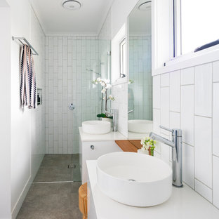 Transitional bathroom in Brisbane with flat-panel cabinets, white cabinets, a curbless shower, white tile, white walls, a vessel sink, beige floor and white benchtops.