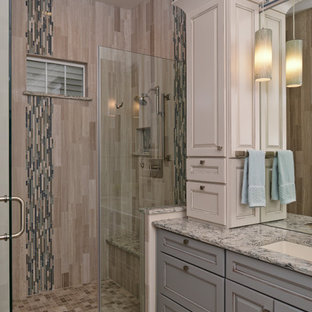 Alcove shower - mid-sized transitional master beige tile and ceramic tile ceramic floor alcove shower idea in DC Metro with a drop-in sink, white cabinets, granite countertops and white walls
