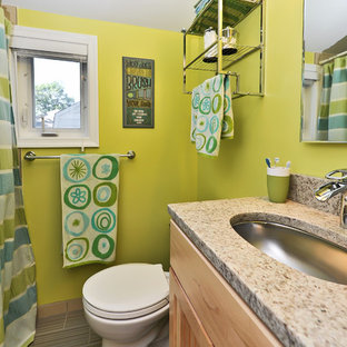 Example of a classic shower curtain design in DC Metro with an undermount sink, shaker cabinets and medium tone wood cabinets