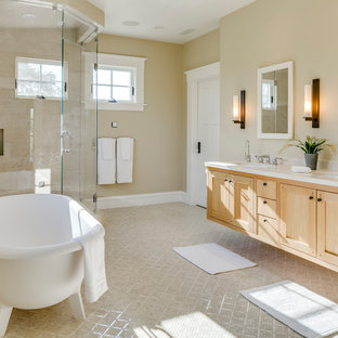 Photo of a mid-sized arts and crafts master bathroom in San Francisco with recessed-panel cabinets, light wood cabinets, a freestanding tub, a corner shower, a two-piece toilet, beige tile, porcelain tile, beige walls, mosaic tile floors, an undermount sink, engineered quartz benchtops, beige floor, a hinged shower door and white benchtops.