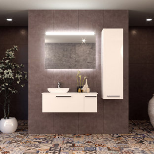 Example of a small minimalist bathroom design in New York with furniture-like cabinets, white cabinets, a vessel sink, solid surface countertops and white countertops