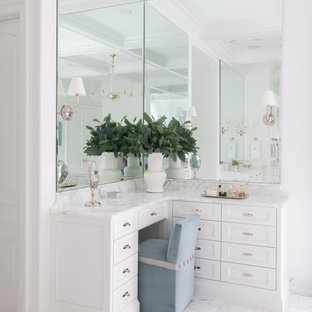 Example of a huge classic master marble floor, white floor and coffered ceiling bathroom design in Dallas with shaker cabinets, white cabinets, white walls, marble countertops, white countertops and a built-in vanity