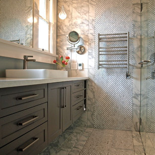 Example of a mid-sized transitional master gray tile and stone tile marble floor bathroom design in Vancouver with a vessel sink, shaker cabinets, gray cabinets, engineered quartz countertops, a two-piece toilet and gray walls