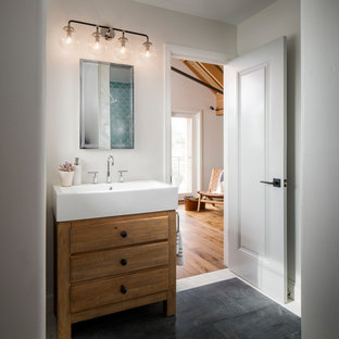 Inspiration for a mid-sized transitional 3/4 ceramic tile porcelain floor and gray floor bathroom remodel in San Francisco with furniture-like cabinets, white walls, quartz countertops, medium tone wood cabinets and a console sink