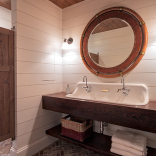 Photo of a mid-sized transitional 3/4 bathroom in Minneapolis with open cabinets, dark wood cabinets, white walls, brick floors, a trough sink, wood benchtops and red floor.