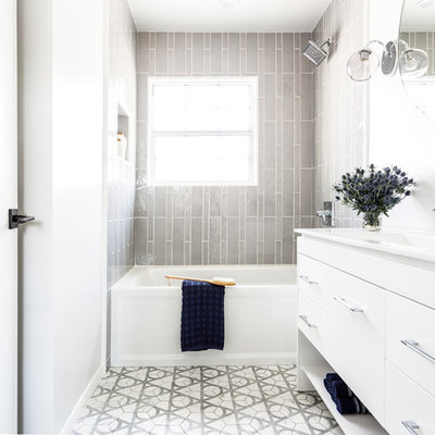 Example of a mid-sized trendy kids' gray tile and ceramic tile ceramic tile and gray floor bathroom design in Los Angeles with flat-panel cabinets, white cabinets, a one-piece toilet, white walls, an integrated sink, quartz countertops and white countertops