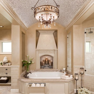 Drop-in bathtub - large traditional master mosaic tile and beige tile travertine floor and beige floor drop-in bathtub idea in Houston with beaded inset cabinets, beige cabinets and beige walls