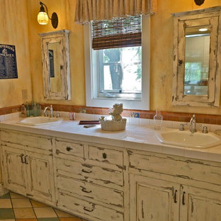 Eclectic multicolored tile bathroom photo in Los Angeles with a drop-in sink, raised-panel cabinets and distressed cabinets