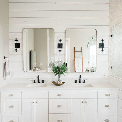 Inspiration for a large country master porcelain tile and gray floor bathroom remodel in Austin with shaker cabinets, white cabinets, white walls, a drop-in sink, quartz countertops, a hinged shower door and white countertops