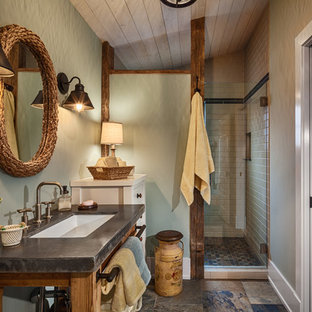 Example of a mid-sized cottage master beige tile and porcelain tile slate floor and multicolored floor alcove shower design in Other with green walls, concrete countertops, open cabinets, dark wood cabinets, a two-piece toilet, an undermount sink and a hinged shower door