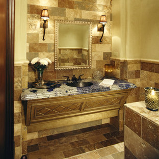 Inspiration for an expansive mediterranean master bathroom in Phoenix with flat-panel cabinets, light wood cabinets, a hot tub, a double shower, a one-piece toilet, beige tile, stone tile, beige walls, travertine floors, an integrated sink and tile benchtops.