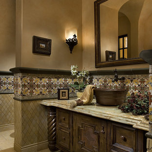 Expansive mediterranean master bathroom in Phoenix with flat-panel cabinets, light wood cabinets, a hot tub, a double shower, a one-piece toilet, beige tile, stone tile, beige walls, travertine floors, an integrated sink and tile benchtops.