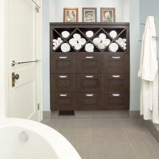 This is an example of a classic bathroom in Toronto with a corner bath, dark wood cabinets, wooden worktops, grey tiles, porcelain tiles, porcelain flooring and shaker cabinets.