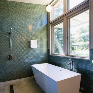Example of a large trendy master glass tile and blue tile concrete floor bathroom design in San Francisco with blue walls