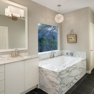 Example of a trendy bathroom design in Austin with an undermount tub and an undermount sink