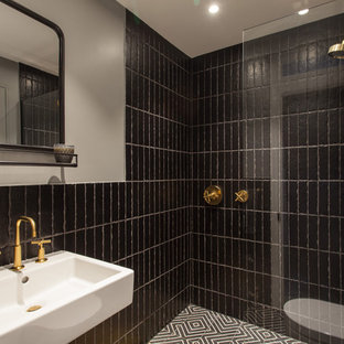 Small contemporary shower room in London with an alcove shower, black tiles, grey walls, a wall-mounted sink, black floors and an open shower.