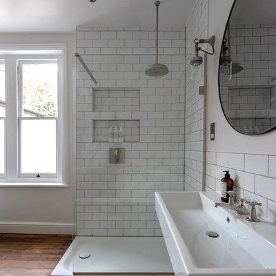 Bathroom - mid-sized victorian kids' medium tone wood floor and brown floor bathroom idea in London with a two-piece toilet, gray walls and a wall-mount sink