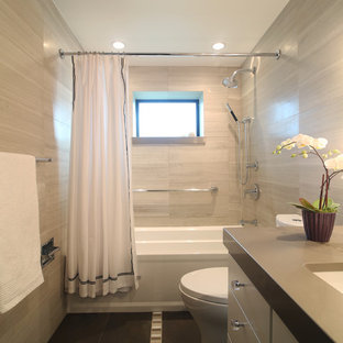Inspiration for a transitional beige tile bathroom remodel in Other with an undermount sink, flat-panel cabinets and beige cabinets