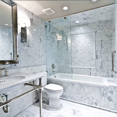 Example of a small eclectic master white tile and subway tile marble floor drop-in bathtub design in Houston with a pedestal sink, furniture-like cabinets, marble countertops and a two-piece toilet