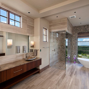 Example of a large trendy master beige tile and stone tile light wood floor bathroom design in Austin with a vessel sink, flat-panel cabinets, dark wood cabinets, marble countertops and beige walls